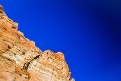 Red Rock Canyon Cliff Face. Towering walls of a cliff face in Red Rock Canyon State park in southern California stock photography