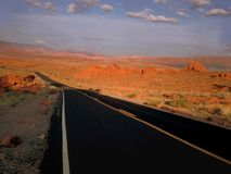 Red Rock Canyon Las Vegas. Tall red rocks off the road Royalty Free Stock Images
