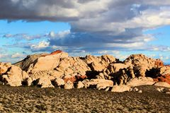 Red Rock Canyon national Conservation Area in Las Vegas Nevada. With clouds over head blue sky stock images