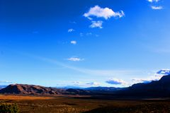 Red Rock Canyon national Conservation Area in Las Vegas Nevada. With clouds over head blue sky royalty free stock photo