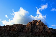 Red Rock Canyon national Conservation Area in Las Vegas Nevada. With clouds over head blue sky stock photography