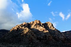 Red Rock Canyon national Conservation Area in Las Vegas Nevada. With clouds over head blue sky stock image