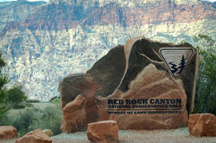 Red Rock Canyon Sign On Stone As You Enter. Stock Photos