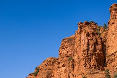 Red Rock Cliff In Arizona. Against Blue Sky Background royalty free stock images