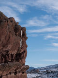 Red rock cliff with icicles Royalty Free Stock Photos