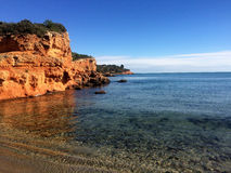 Red rock cliff on the mediterranean sea Stock Images