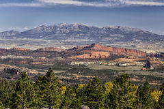 Red Rock Cliffs and the Henry Mountains. View of the Red cliffs of Capital Reef National Park and the Henry mountains from Boulder Mountain in Utah USA in the Stock Photos
