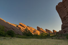 Red Rock cliffs and valley floor sunrise Stock Images