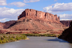 Red Rock Colorado River. Red Buttes tower above the Colorado River near Moab, Utah Stock Photo