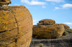 Red Rock Coulee. Odd round red concretions sitting in a line in Alberta, Canada Stock Image