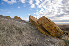 Red Rock Coulee. Odd round red concretions sitting in a line & split in half in Alberta, Canada Royalty Free Stock Photo