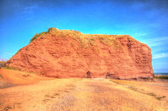 Red rock Dawlish Warren Devon England on a summer day in HDR Royalty Free Stock Image