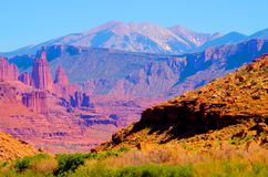 Red rock desert landscape near Moab, Utah. Mountains and blue sky in the background royalty free stock images