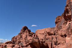 Red rock formation against blue sky Royalty Free Stock Images