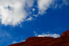 Red rock formation, blue sky, white clouds, red rock country, Arizona royalty free stock image