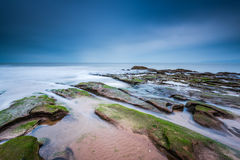 Red rock formation at Exmouth beach in Devon, UK Royalty Free Stock Images