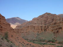 Red rock formations in Canyon Konorchek in Kyrgyzstan Stock Images