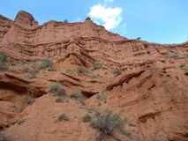 Red rock formations in Canyon Konorchek in Kyrgyzstan Stock Photos
