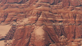 Red rock formations closeup. Closeup view of the red rock formations in a canyon during daytime. Camera moves from the bottom up. Realistic three dimensional stock video