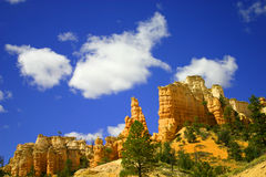 RED ROCK FORMATIONS IN THE DESERT OF UTAH. RED ROCK FORMATIONS IN THE DESERT IN UTAH ON A BEAUTIFUL DEEP BLUE SKY AND CLOUDS DAY Royalty Free Stock Image