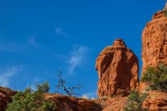Red Rock Formations Against Blue Sky Background Royalty Free Stock Image