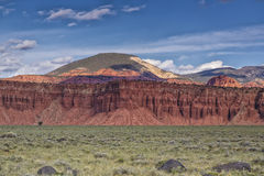 Red Rock and Green Meadows Stock Photography