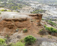 Red rock in landscape Oldupai Gorge Royalty Free Stock Photography