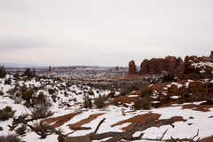 Red Rock Landscape in Snow in Utah. Snow covers the rich red earthly colours in Arches National Park Utah Stock Images