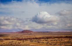 Clouds over New Mexico Red Rock Landscape, Southwest USA. Red Rock Landscape, Southwest USA clouds over New Mexico royalty free stock photography