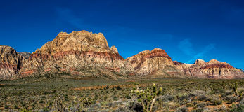 Red Rock Mountain Range Panorama. Panoramic shot of the Red Rock Canyon area just outside of Las Vegas, NV Stock Photos