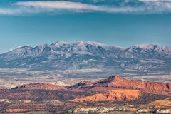 Red Rock and Mountains. View from highway 12  looking over Capital Reef national park with red rock and the Henry mountains behind them in Utah USA Royalty Free Stock Image