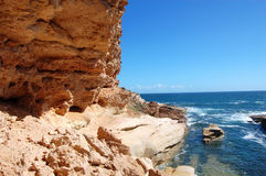 Red rock and ocean. Cave and cliffs, blue ocean, South Australia Stock Photo