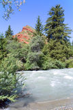Red Rock over the fast mountain river. Kyrgyzstan Stock Photo