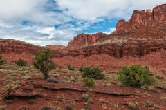 Red Rock Paradise. Capital Reef National Park in Utah USA red rock cliffs and dirt with a partly cloudy sky's in the late summer Royalty Free Stock Photography