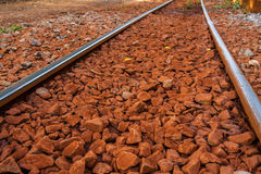 red rock and Railway Tracks , stone background Royalty Free Stock Photo