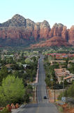 Red Rock Road. Vertical image of a road leading to red rocks in the background Royalty Free Stock Photo