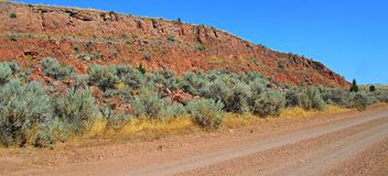 Red Rock Road. Red rock bluffs along Jasper Road - Crooked River National Grassland - near Culver, OR royalty free stock image