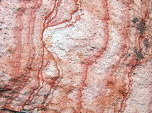 Red Rock Texture. Close-up of stone with red striations. Good for textures and backgrounds. Or for geology students Stock Photos