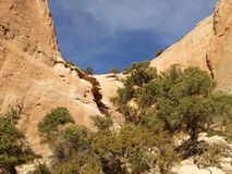 A red rock wall and blue sky Royalty Free Stock Photo