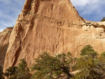 A red rock wall and blue sky Royalty Free Stock Image