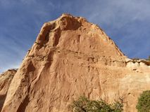 A red rock wall and blue sky Stock Image
