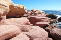 Red rocks. In the coast Stock Photos