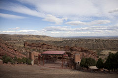 Red Rocks Amphitheatre. The Red Rocks Amphitheatre is located in the Rocky Mountain Foothills, fifteen minutes west of Denver. It is owned by the city and county Stock Photos
