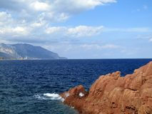 Red Rocks at Arbatax, Sardinia. Arbatax famous for it`s Red Rock formations. Landscape in the background with strikingly blue sea. Italy Stock Photos