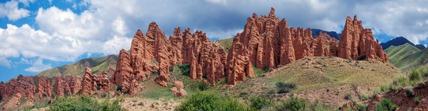 Red rocks on the Assy mountain plateau. Kazakhstan. In the summer, the plateau of Assi strikes the imagination with the brightness of colors and a huge variety Royalty Free Stock Photography