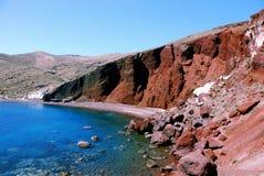 Red rocks, beach - Santorini island, Greece. Red rocks on Santorini Island - Greece. Blue sea, sky and sandy beach Royalty Free Stock Photography