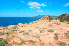 Red rocks and blue sea Stock Photography