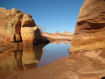 Red rocks and canyon in desert. Valley of Fire in Nevada. The rock is red among desert landscape. A watering hole is shown in winter Stock Photography