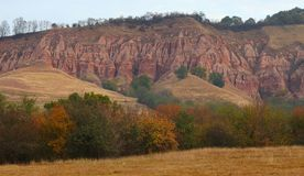 Red rocks in canyon in the fall. Profiled on cloudy sky Royalty Free Stock Photography