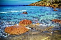 Red rocks in Castelsardo shoreline in hdr Stock Photos